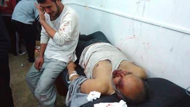 Des blessés à l'hôtipal de Homs