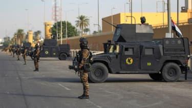 Un soldat irakien devant l'ambassade américaine à Bagdad le 2 janvier dernier (Photo d'illustration).