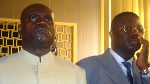 Norbert Dabira, à droite, en 2005. A ses côtés, Blaise Adoua, soupçonné d'être mêlé à la même affaire, et décédé en avril dernier.