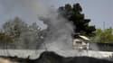 """Colonne de fumée près de l'ambassade de Grande-Bretagne à Kaboul. Les taliban afghans ont lancé dimanche leur """"offensive de printemps"""" en attaquant de multiples cibles à Kaboul, dont le Parlement et des ambassades occidentales, ainsi que dans deux provinc"""