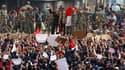 Place Tahrir, au Caire, épicentre de la contestation en Egypte. Des milliers de personnes sont redescendues samedi dans les rues de la capitale et d'Alexandrie, réclamant la démission d'Hosni Moubarak et rejetant son appel au dialogue. /Photo prise le 29