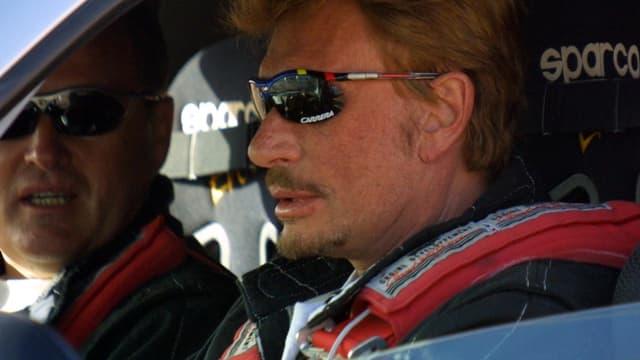 Johnny Hallyday et son beau-père André Boudou lors d'un rallye au Maroc en 2001