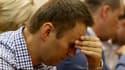 L'opposant russe Alexeï Navalny, reconnu coupable de détournement de fonds par un tribunal de Kirov, a été condamné jeudi à cinq années de prison. /Photo prise le 18 juillet 2013/REUTERS/Sergei Karpukhin