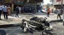 La carcasse d'une voiture explosée lors d'un attendant à la bombe, le 19 mars, à Bagdad.