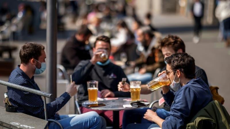 la Suisse assouplit les mesures sanitaires plus vite que prévu