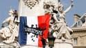 Sur la statue de la République au milieu de la place du même nom,à Paris. Des dizaines de milliers de personnes sont descendues dans la rue samedi dans toute la France pour dénoncer la politique sécuritaire du gouvernement, accusé de répression et de xéno