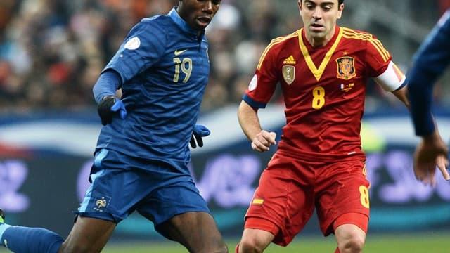 Paul Pogba face à Xavi