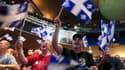 A Montréal, partisans du Parti québécois (PQ) de Pauline Marois, qui a remporté mardi les élections organisées dans la province canadienne francophone sans toutefois parvenir à obtenir une majorité absolue. /Photo prise le 4 septembre 2012/REUTERS/Christi
