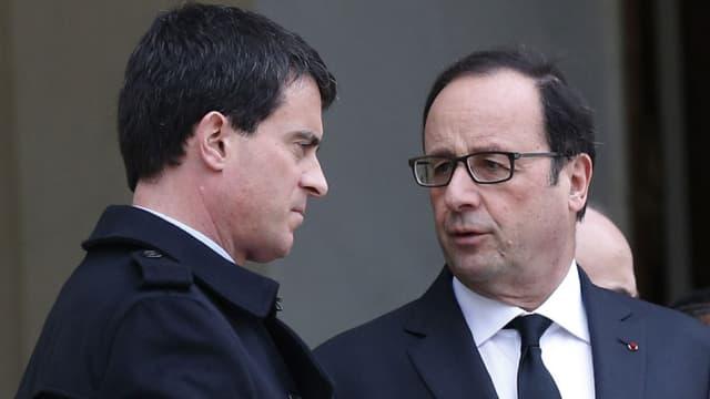La popularité de François Hollande (D) et Manuel Valls (G) est en hausse pour le 3e mois consécutif.