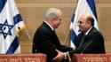 Le Premier ministre israélien Benjamin Netanyahu (à gauche), ici avec Shaul Mofaz à la tête de Kadima, a négocié un accord avec la principale force d'opposition pour former un gouvernement d'unité nationale, abandonnant ainsi son projet d'élections et obt