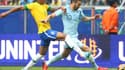 Luiz Gustavo face à Karim Benzema