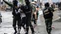 Un manifestant est arrêté dans une manifestation contre le gouvernement à Caracas, au Venezuela, le 28 juillet 2017.