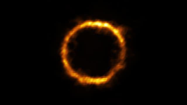 La galaxie SPT0418-47, située à 12 milliards d'années-lumière, capturée par le téléscope ALMA