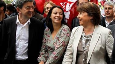 Martine Aubry (à droite) côtoie les responsables des Verts Cécile Duflot et du Parti de Gauche Jean-Luc Mélenchon dans une manifestation, en septembre. Quarante-huit députés socialistes ont appelé lundi le premier secrétaire du PS à rassembler la gauche a
