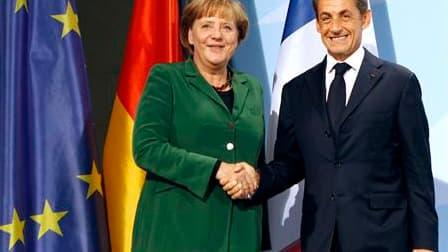 """La France et l'Allemagne se sont engagés dimanche à apporter une réponse """"durable et globale"""" à la crise de la zone euro pour le sommet du G20 de Cannes prévu début novembre, qui passera notamment par une recapitalisation des banques européennes. Nicolas"""