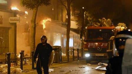 A Woolwich, dans le sud-est de Londres. De nombreux quartiers de Londres mais aussi des villes de province ont été le théâtre d'une troisième nuit d'émeutes et de pillages. Le Premier ministre britannique David Cameron doit tenir une réunion de crise ce m