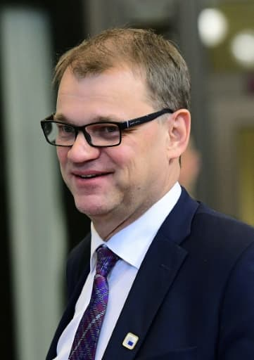 Le Premier ministre finlandais Juha Sipilä, ici le 21 octobre 2016 à Bruxelles, est devenu millionnaire grâce à son activité d'entrepreneur dans les technologies avant d'embrasser la politique