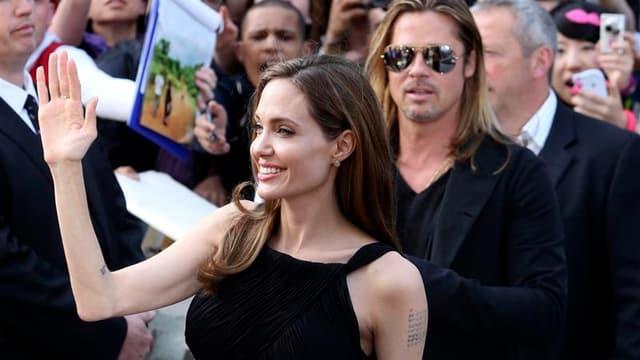 L'actrice américaine Angelina Jolie, aux côtés de Brad Pitt, a effectué dimanche à Londres sa première apparition publique depuis l'annonce le mois dernier de la double mammectomie qu'elle avait subie pour des raisons liées à un risque élevé de cancer du