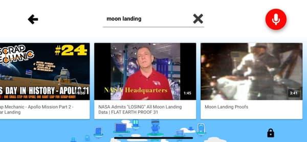 """Cette capture d'écran (Business Insider) montre que trois vidéos conspirationnistes ressortent dans les résultats pour """"alunissage"""""""