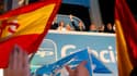Célébration de la victoire au siège du Parti populaire espagnol. Emmenés par Mariano Rajoy (au centre, bars levé), les conservateurs ont remporté dimanche une écrasante victoire aux législatives en profitant de la colère envers le gouvernement socialiste