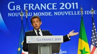 """A Deauville, Nicolas Sarkozy a confirmé un plan d'aide du G8 de 40 milliards de dollars en faveur des pays du """"printemps arabe"""". /Photo prise le 27 mai 2011/ REUTERS/Philippe Wojazer"""