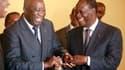 Le chef de l'Etat sortant Laurent Gbagbo (à gauche) et l'ancien Premier ministre Alassane Ouattara, à Abidjan, les deux candidats à la présidentielle ivoirienne. La Côte d'Ivoire est appelée aux urnes dimanche pour le second tour de ce scrutin dans un cli
