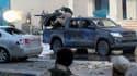 Combattants du Conseil national de transition (CNT) libyen lors d'une attaque visant les forces fidèls à Mouammar Kadhafi à Syrte. Le CNT a envoyé vendredi des blindés en renfort à Syrte, à 450 km à l'est de Tripoli, pour tenter d'écraser les dernières po