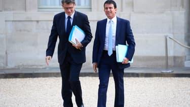 Vincent Peillon et Manuel devant le Palais de l'Élysée en août 2013.
