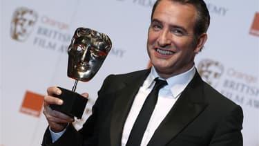 """Le film """"The Artist"""" a remporté dimanche le trophée BAFTA du meilleur film, remis par l'Académie britannique du cinéma et de la télévision à la Royal Opera House de Londres. Plusieurs autres récompenses ont été remises dans la soirée à cette oeuvre muette"""