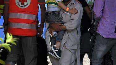 Des réfugiés afghans arrivent à Strasbourg pour être hébergés dans un hôtel, le 26 août à Strasbourg