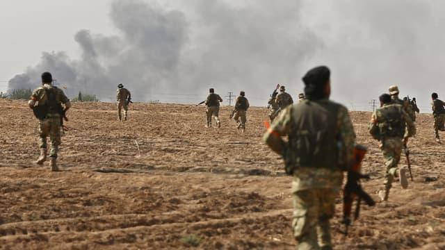 Des combattants syriens pro-turcs, le 11 octobre 2019 - Nazeer Al-khatib / AFP