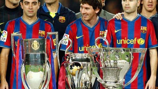 Xavi, Messi et Iniesta