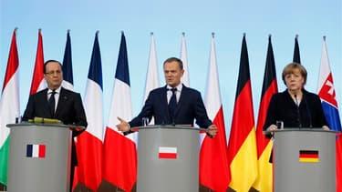 Conférence de presse de François Hollande, du Premier ministre polonais Donald Tusk et de la chancelière allemande Angela Merkel à Varsovie. Symbole des insuffisances de la politique européenne de défense, le conflit malien s'est révélé mercredi comme un