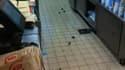 Une image des rats traversant les cuisines du Quick de Belleville