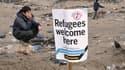 Un migrant non loin du port de Calais lors de la manifestation de samedi