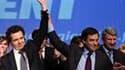 François Fillon (au centre) a assuré, lors d'un meeting de soutien au candidat UMP en Pays de la Loire Christophe Béchu (à gauche) à Nantes, qu'il ne cédait pas au pessimisme et a appelé les électeurs à faire mentir les sondages qui promettent à la gauche