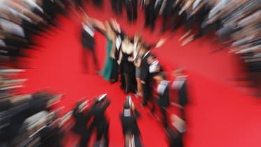 Montée des marches du Palais des Festivals à Cannes.