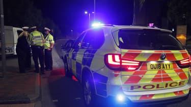 La police anglaise à Reading, après une attaque au couteau samedi 20 juin 2020.