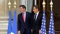 Nicolas Sarkozy aux côtés de l'ambassadeur des Etats-Unis Charles Rivkin, dans l'enceinte de la mission américaine, à Paris. Le président français a rendu hommage vendredi aux victimes du 11 septembre 2001 et déclaré que le printemps de la démocratie arab