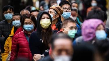 Des habitants de Hong Kong équipés de masques (photo d'illustration)