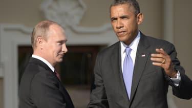 Vladimir Poutine salue Barack Obama à l'occasion de l'ouverture du G20 le 5 septembre 2013 à Saint-Pétersbourg.