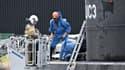 """La police danoise inspecte le sous-marin """"UC3 Nautilus """" à  Copenhague le 13 août."""