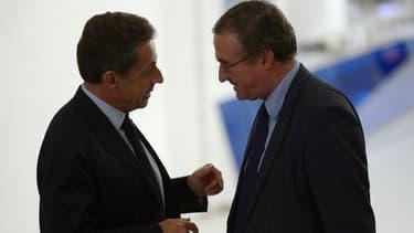 Nicolas Sarkozy et Hervé Mariton au siège de l'UMP le 2 décembre 2014.