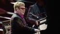 Elton John, 66 ans, qui a épousé en 2005 son partenaire de longue date, David Furnish, est un ardent défenseur de la communauté LGBT dans le monde. Ici en concert le 4 décembre au Madison Square Garden, à New York.
