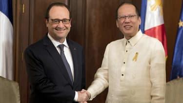"""""""Il faut changer le monde pour sauver la planète"""", a lancé jeudi François Hollande depuis les Philippines."""