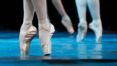 """Des danseurs du Ballet national anglais jouent """"Le Lac des Cygnes"""", le 2 août 2012 lors des Jeux Olympiques. (Photo d'illustration)"""