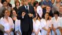 En déplacement dans les Vosges sur le thème de l'emploi, Nicolas Sarkozy a annoncé vendredi le déblocage d'une enveloppe pour la création de 20.000 contrats aidés supplémentaires d'ici la fin de l'année. /Photo prise le 2 septembre 2011/REUTERS/Philippe W