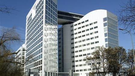 Le Parlement a adopté mardi le projet de loi qui adapte le droit pénal français à la Cour pénale internationale de La Haye (photo). Les juges français pourront à l'avenir poursuivre et juger les étrangers coupables de génocides, de crimes de guerre et de