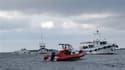 Les corps d'une centaine de personnes sont toujours bloqués dans l'épave du Bulgaria, bateau de croisière qui a fait naufrage sur la Volga dimanche, selon les plongeurs qui ont fouillé le fleuve russe et ont remonté douze corps lundi. /Photo prise le 11 j