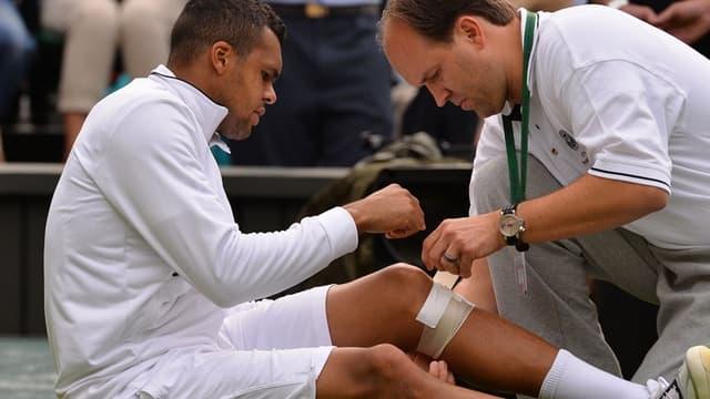 Jo-Wilfried Tsonga s'est blessé au genou gauche à Wimbledon